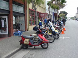 Santa Cruz Vespa Club parked in front of the Museum