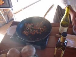 Sauteeing mushrooms (see recipe)