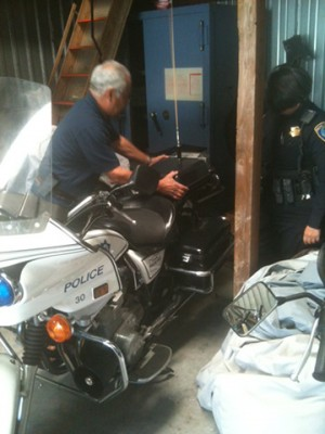 Sgt. Viray finishes unwrapping the Kawasaki