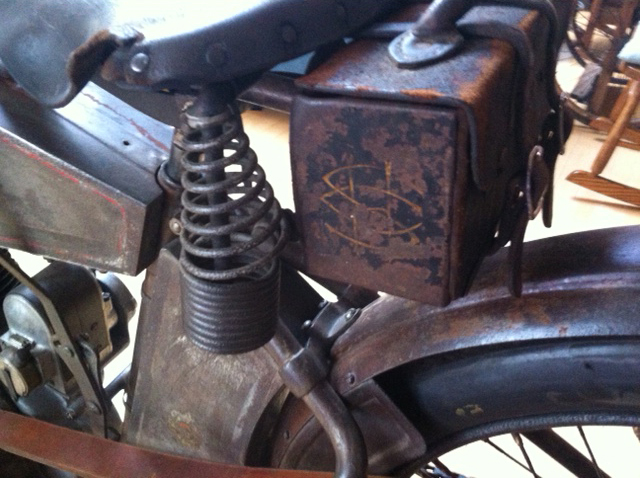 Tool kit behind and under the seat
